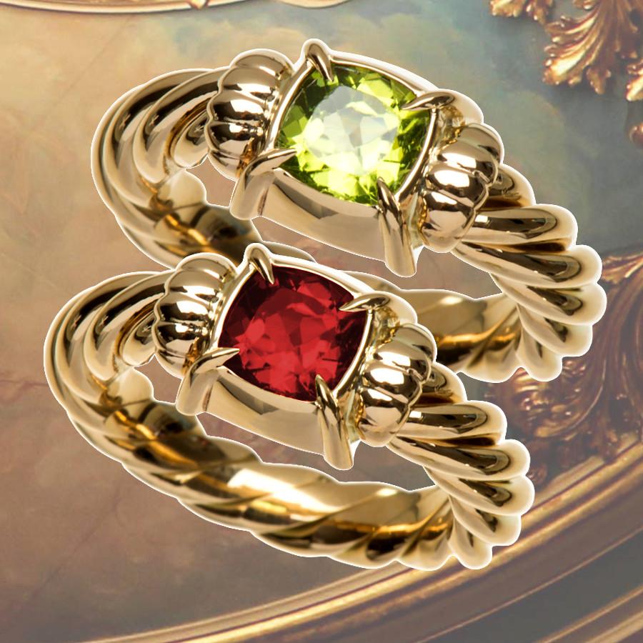 Ringe mit gekordelter Schiene und barocken Edelstein-fassungen mit Peridot (€ 1675,0) oder Rhodolith (€ 1645,00)