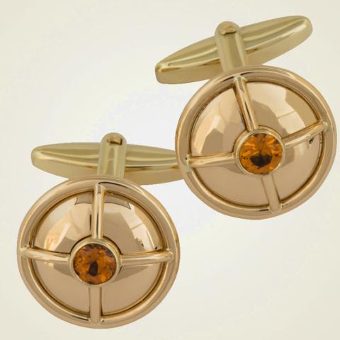 Manschettenknöpfe in Gelbgold mit Klappmechanik und einem orangefarbenen Granat