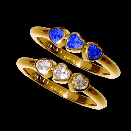 Ringe mit Brillant-Herzen oder Saphir-Herzen in Gelbgold gefasst