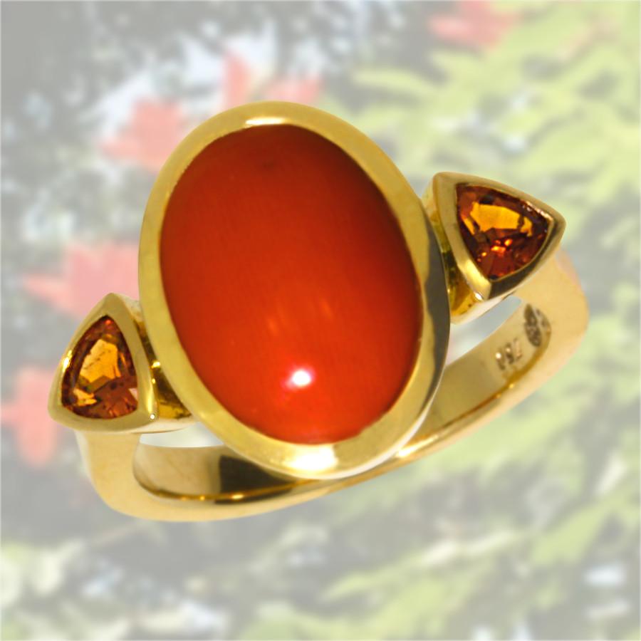 Ring mit Koralle und Mandaringranaten in 750 Gelbgold