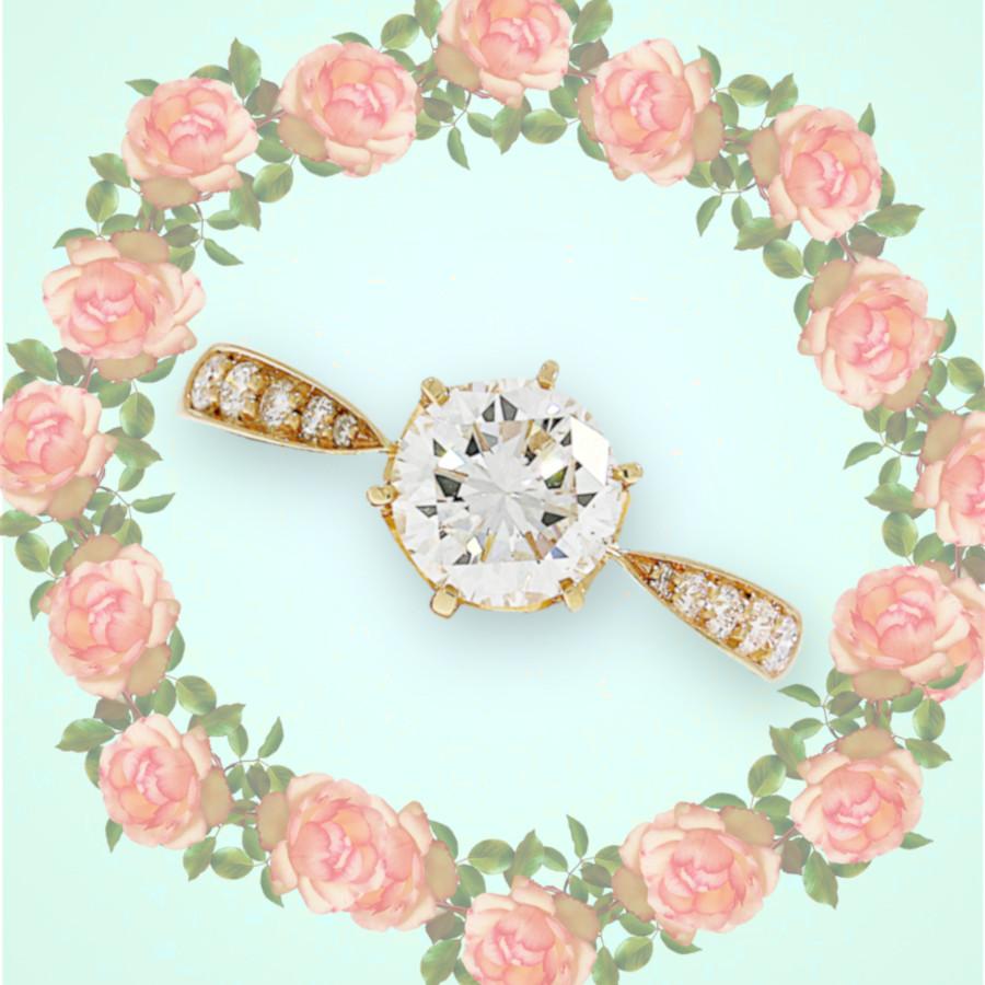 Verlobungsring in Rosegold mit Solitaire-Brillanten und zarter Ringschiene